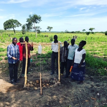 Third-year Chasefu Theological College seminary students with the completed tippytap handwashing station, from left to right: Haswell, William, Sylvester, Tendsheep, Billy, Tryson and Nellas.