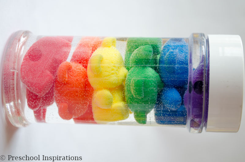 Make a rainbow counting bear sensory bottle. Perfect for a rainbow theme.