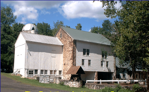 Color photo shows rehabilitated barn