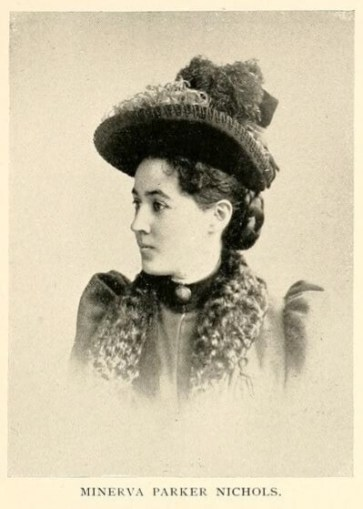 Black and white photograph of a woman in 3/4 profile. She is wearing a hat with feathers, a brooch at her neck and a jacket with puffy sleeves and a trimmed collar