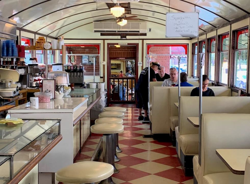 Interior view of the diner, with its distinctive barrel-vaulted ceiling. Take a seat at the counter on the left or plop into a comfy booth on the right.