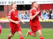 Andrew Driver and Adam Rooney celebrate after the duo combined for the opening goal