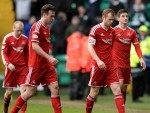 Dejected Dons players trudge off the Parkhead pitch on Sunday