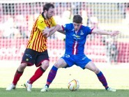 Stuart Bannigan and Ryan Christie battle for possession