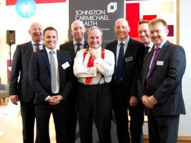 JC Wealth & 7IM teams with Justin Urquhart Stewart (centre)