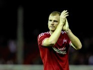 Mark Reynolds salutes the Dons support