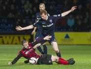 Scott Boyd and James McFadden challenge for the ball