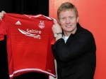 Barry Robson is delighted to have committed to the Dons for another season