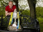 David Raven poses with the Scottish Cup