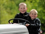 Pitgaveny Farm Open Day. Brothers Liam, left, and Callum, right,  Barrowdale on a tractor. Picture by Gordon Lennox