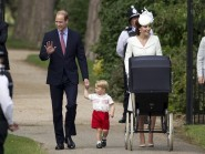 Prince William, Kate the Duchess of Cambridge, their son Prince George and daughter Princess Charlotte in a pram arrive for Charlotte's Christening. (AP)