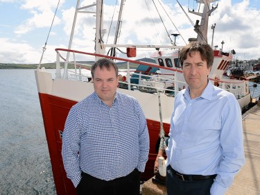 Simon Collins, right, with Shetland Fish Producers' Organisation chief executive Brian Isbister