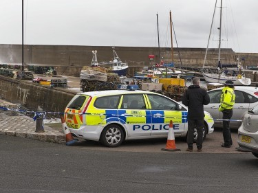 Police on the scene at Whitehills harbour following the discovery of the body