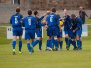 Huntly players celebrate during Saturday's 5-1 win