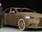 Ruben Marcos of Scales and Models next to a full-size origami inspired Lexus IS Saloon