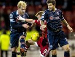 Ross County pair Andrew Davies (left) and Richard Foster battle with Adam Rooney