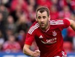Aberdeen's Niall McGinn was impressed by how he and his team-mates dug deep to beat Ross County