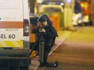 A police officer takes cover during the raid