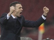 Ross County manager Jim McIntyre celebrates County's League Cup semi-final victory against Celtic.