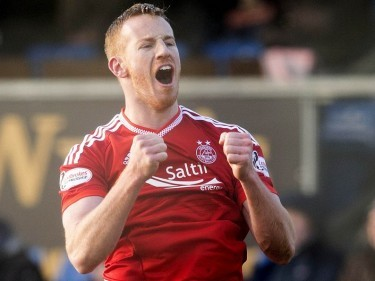 Rooney says Dons are not feeling the pressure in title race