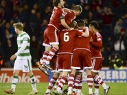 The Aberdeen players celebrate  Jonny Hayes opening goal