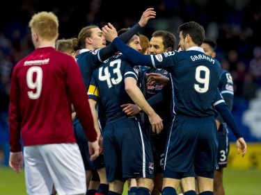 Ross County's Paul Quinn (centre) celebrates after making it 1-0