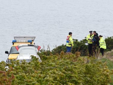 Police investigate at Kinneff yesterday. Picture: Kenny Elrick.
