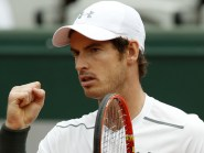 Andy Murray, pictured, eased into the fourth round of the French Open with victory over Ivo Karlovic (AP)