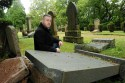 Allan Duffy next to one of the ruined gravestones