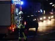 A firefighter stands at a road block in Wuerzburg where man attacked people in a train and injured more than a dozen. (Karl-Josef Hildenbrand/dpa via AP)