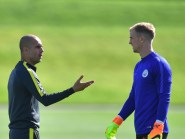 Manchester City manager Pep Guardiola spoke to goalkeeper Joe Hart during training