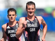 Jonny Brownlee, left, was denied a second world title despite being helped over the line by his brother Alistair, right, in Cozumel