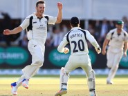 Middlesex bowler Toby Roland-Jones celebrates taking the final wicket of Yorkshire's Ryan Sidebottom