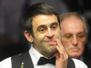 Ronnie O'Sullivan, pictured, returned to action with a 5-4 win over Liang Wenbo