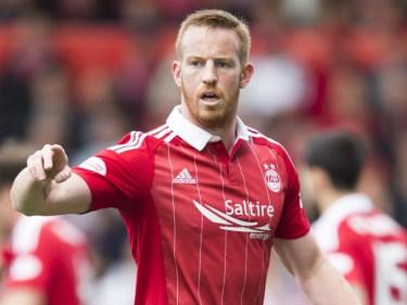 Adam Rooney's header sent Aberdeen on their way to semi-final victory.
