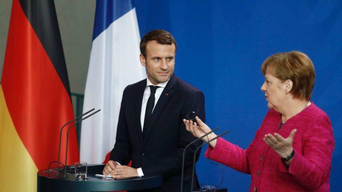 Emmanuel Macron ,Angela Merkel.