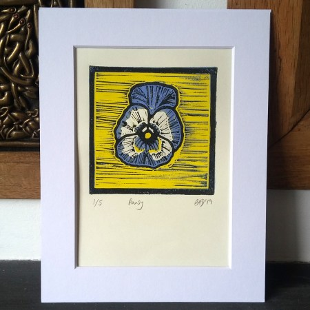 Pansy reduction lino print © 2019 Carrie Dennison