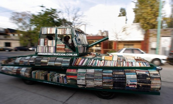 "Artist Raul Lemesoff drives his vehicle called ""Arma de Instruccion Masiva"" (weapon of mass instruction) through the streets of Buenos Aires"