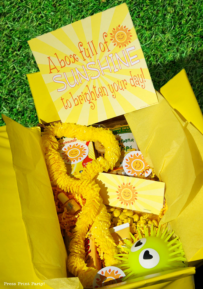 Yellow box with printable happy suns and yellow gifts with text printable sunshine, brighten someone's day.
