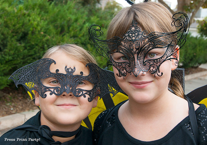 girl in bat mask and girl in butterfly mask - Press Print Party!