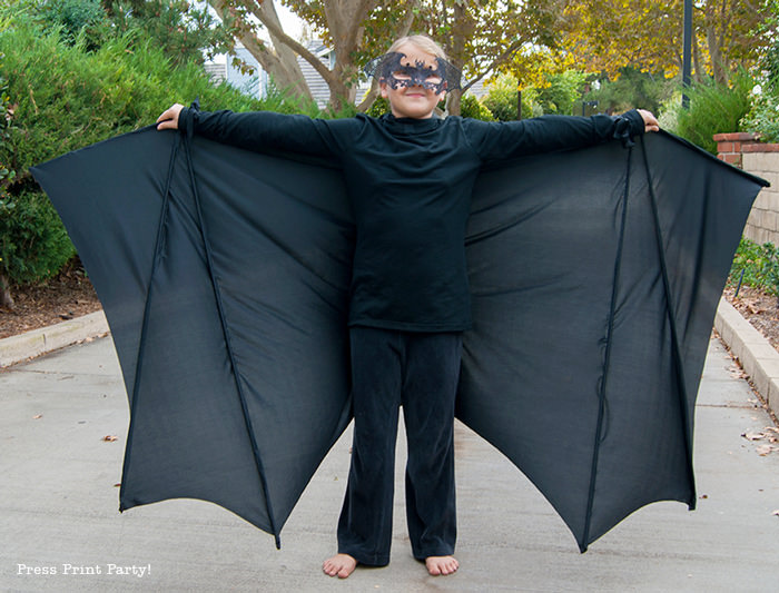 Girl with bat costume open wings - Press Print Party!