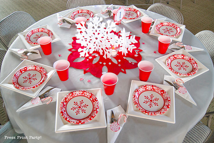 DIY Christmas Centerpiece Ideas with candles red snowflake red and white christmas paper plates with red cup. grey tablecloth. red paper plates, big red felt snowflake - Press Print Party!