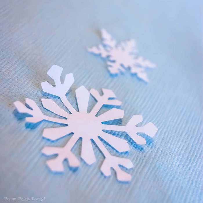 white snowflake punch confetti For Christmas table decor ideas blue and silver winter wonderland decorations. Christmas tablescape for large event christmas party, diy holiday table setting. by Press Print Party!