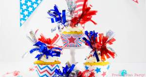 3 patriotic cupcakes with fireworks tassels toppers