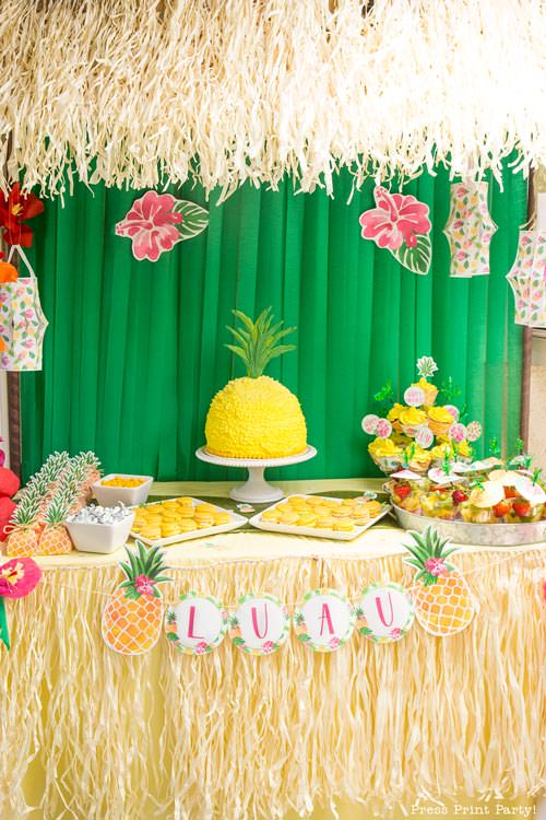 Party like a Pineapple -Tiki hut with dessert table w pineapple cake and cupcakes, pineapple banner and lanterns. Pineapple party - Luau Party - by Press Print Party!