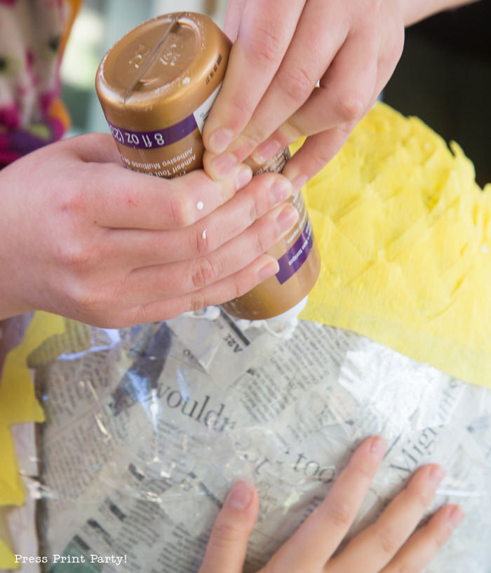 Pineapple Pinata Tutorial, the good, the bad and the funny! How to make a pineapple pinata. Gluing the streamers on the pinata