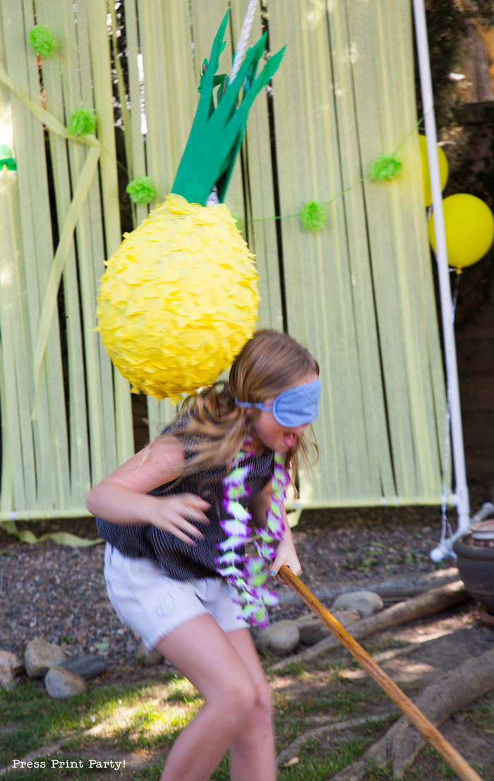 Pineapple Pinata Tutorial, the good, the bad and the funny! How to make a pineapple pinata. By Press Print Party! Girl swinging at pinata