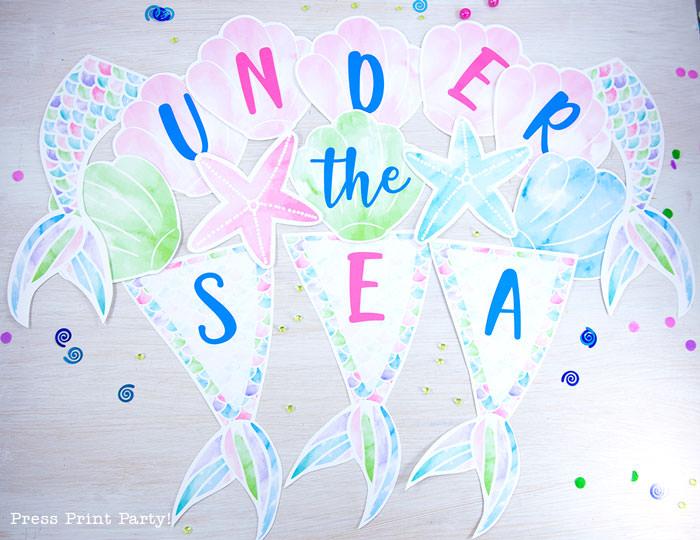 mermaid party banner printable with starfish, mermaid tail and seashells