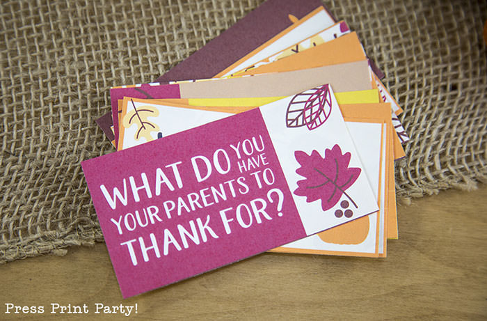 Free Thanksgiving printable conversation cards for Thanksgiving dinner activity. Game for Thanksgiving. free printable Thanksgiving ideas for dinner. What to do at Thanksgiving dinner. With questions to boost conversation. Fall leaves design. Put them in a jar with label. Press Print Party! What are you thankful for? What do you have your parents to thank for?