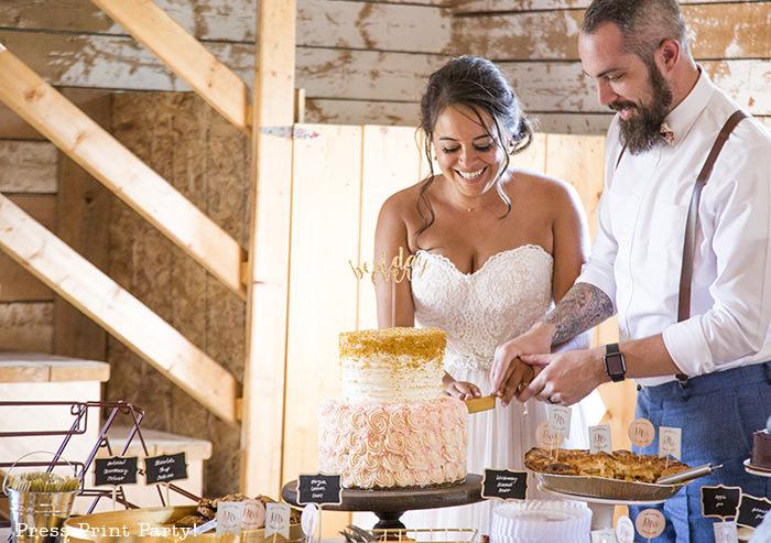 A breathtaking rustic barn wedding - country wedding - Press Print Party! cutting the cake